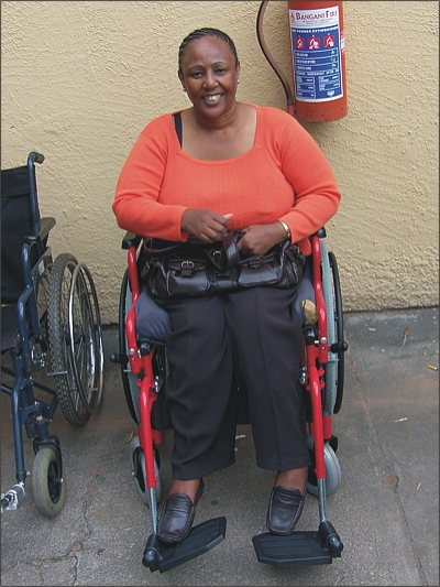 Duduzile Zulu, thrilled with her new wheelchair, donated by Jesus Christ Latter Day Saints